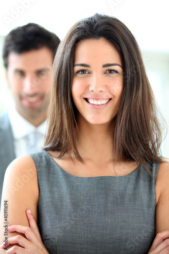 Portrait of smiling businesswoman wearing grey dress