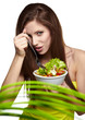 The beautiful cheerful young woman has breakfast salad