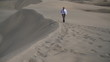 Young businessman walking on the desert