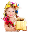 Child with flower holding gift box.
