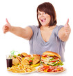 Woman eating fast food.