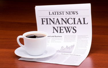 The newspaper LATEST NEWS.with the headline  FINANCIAL NEWS