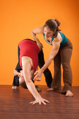 Yoga Instructor Helping Student