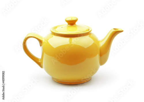 Bright orange teapot isolated on white background