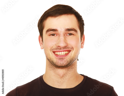 Closeup portrait of a young smiling guy, isolated on white