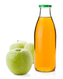 Apple juice in a glass bottle and three ripe apples