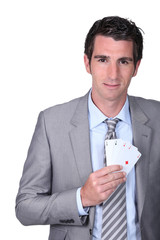 Black man with poker cards