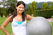 Woman exercising with Swiss ball