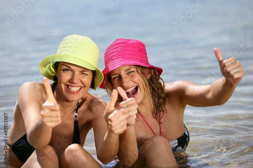 Two women bathing in the sea