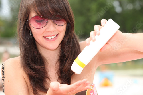 Young woman protecting herself from the sun's harmful rays