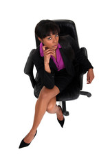 Businesswoman sat in chair concentrating