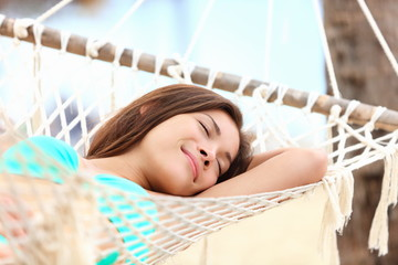 Vacation woman in hammock sleeping