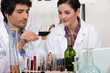 Couple in a wine laboratory
