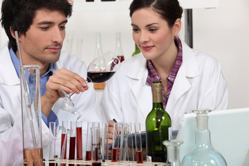 Couple in a wine laboratory