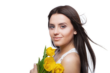 Portrait of beautiful girl with tulips isolated on white