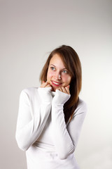 Young girl in white sweater