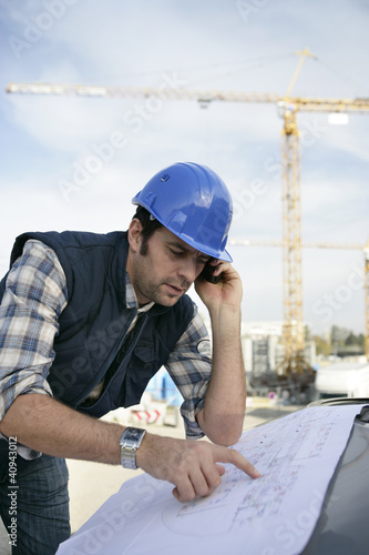 Foreman checking plan
