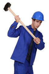 construction worker using a sledge hammer