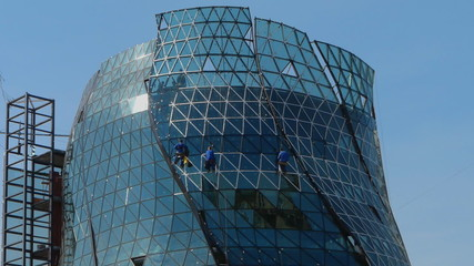 Modern glass building is under construction
