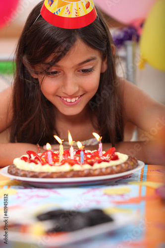 Girl blowing candles