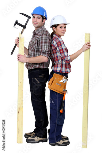 Tradespeople holding tools and materials