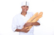 Female baker with baguette