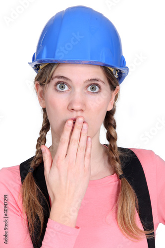 Embarrassed female builder