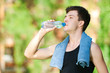 Man drinking water after fitness