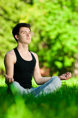 A young man doing yoga exercise