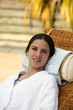 woman in a bathrobe relaxing in a spa center