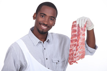 Butcher with a rack of ribs