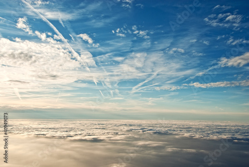 Wall mural heavenly view of sky & clouds from a jet plane