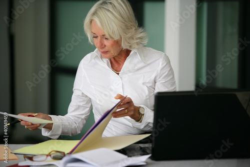 Woman looking through some files