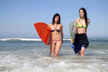 Two female surfers