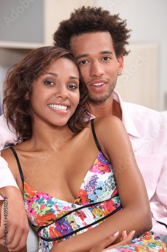 Couple sitting embraced