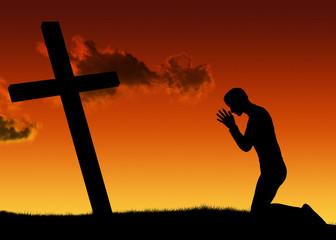 Silhouette uomo in preghiera