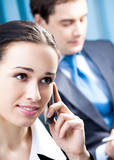 Businesswoman with cellphone at office