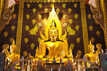 gold buddha inside thai church