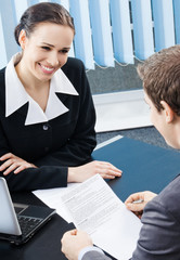 Businesspeople, or business woman and client