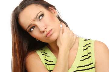 Young woman holding her neck because of pain