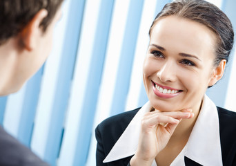 Businesspeople, or businesswoman and client