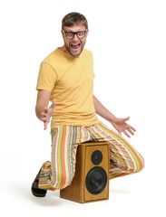 Funny man dancing on the speaker, concept party