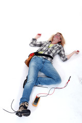 Female electrician suffering an electric shock