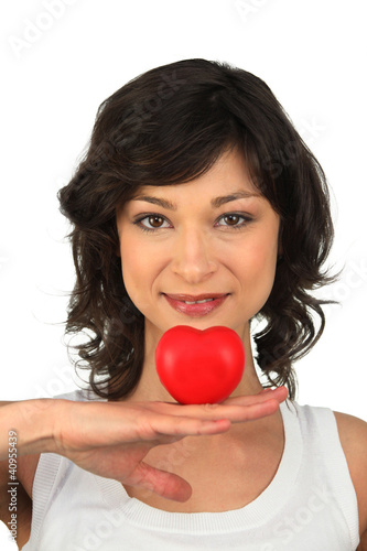 Brunette girl with heart in hand