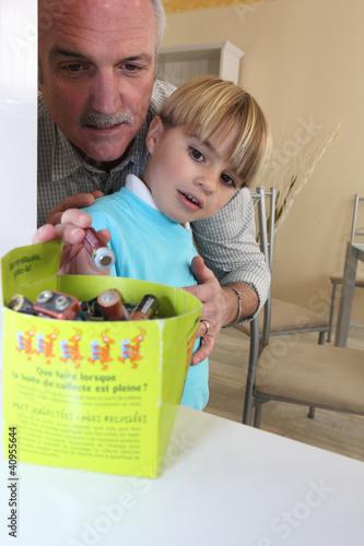 Boy recycling batteries