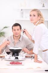 Friends eating fondue
