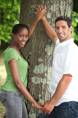 Couple touching tree