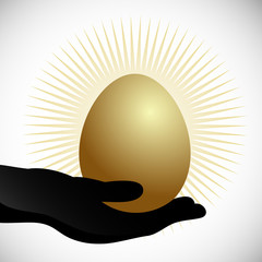 Hand Holding Golden Egg