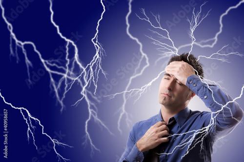 Businessman mit Kopfschmerzen