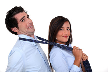 Woman grabbing man by tie